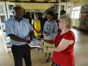 Mary Weeks Millard giving Christian books to Star School, Rwanda