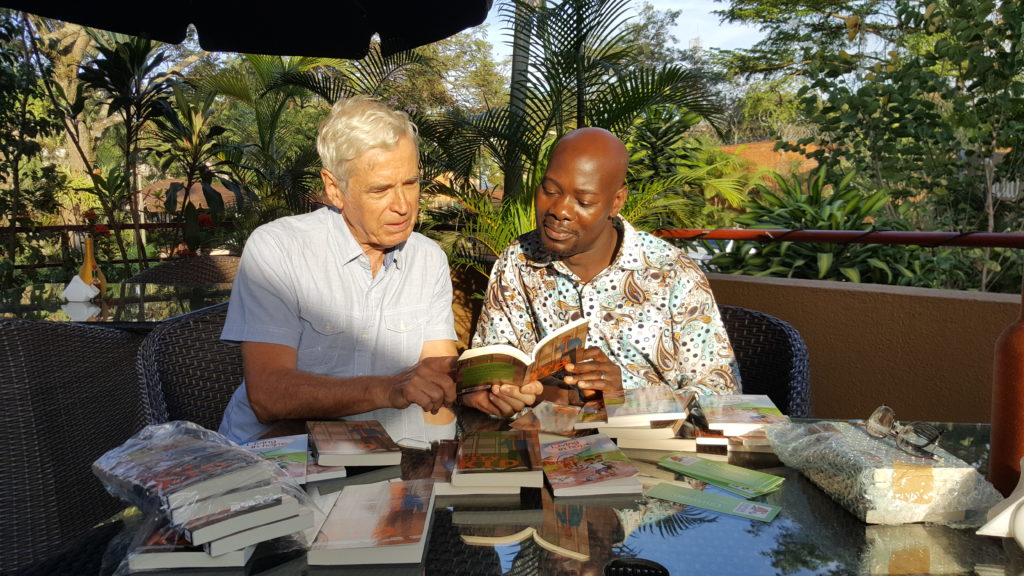 Dickens Zziwa, National Director of SU Uganda, with author Clive Lewis