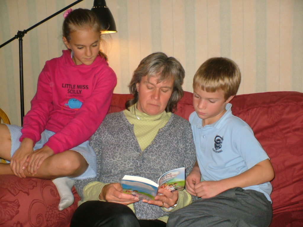 Mum reading with children