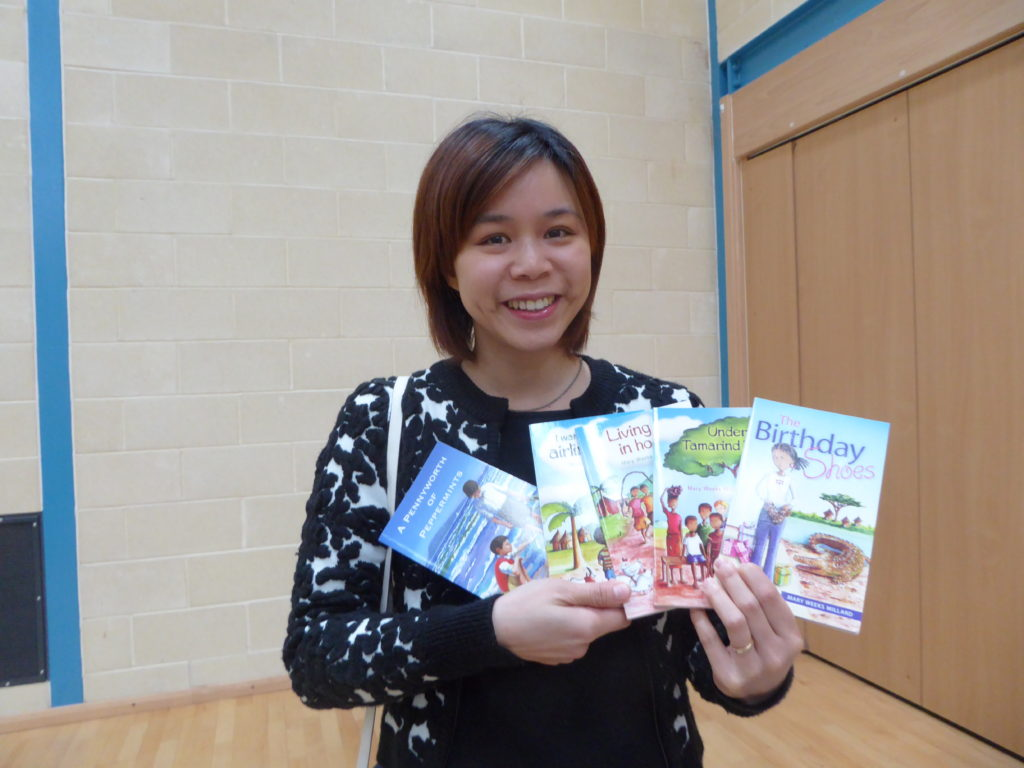 Lady with books for young people