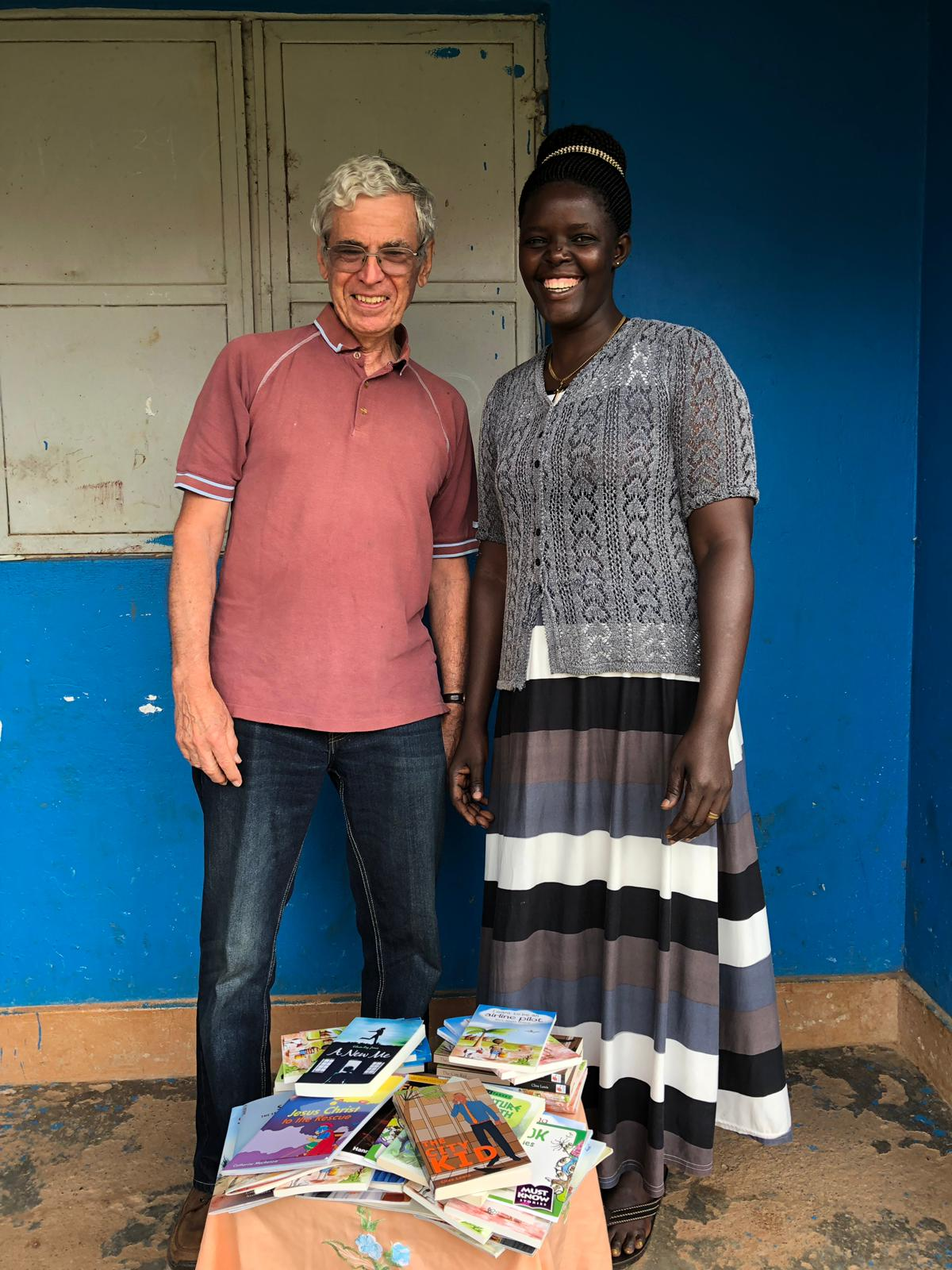 Author Clive Lewis with Rev Eunice Opok from Uganda